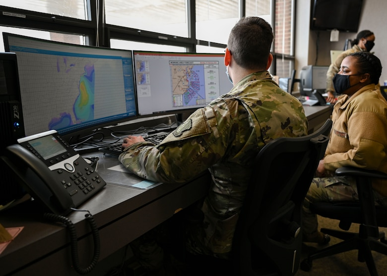 Airmen looking at weather