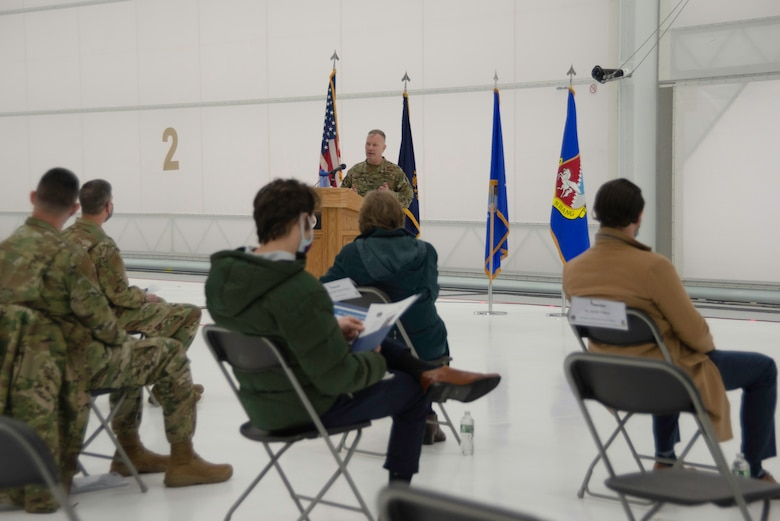 U.S. Air Force Col. John Pogorek, 157th Air Refueling Wing commander, addresses dignitaries gathered inside a hangar for the delivery of the unit's twelfth and final aircraft to Pease Air National Guard Base, Newington, N.H., Feb. 5, 2021.