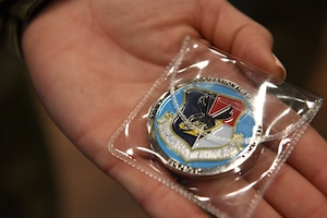 U.S. Air Force Tech. Sgt. Brittney Morgan a recruiter with the 145th Airlift Wing displays a coin she received from Brigadier General Allan R. Cecil the North Carolina Air National Guard Chief of Staff, while at the, NCANG Base, Charlotte Douglas International Airport, February 7. 2021. Brigadier General Cecil presented TSgt Morgan with a coin in recognition of her outstanding performance as a recruiter, going above her yearly recruiting goal by 147% during 2020.