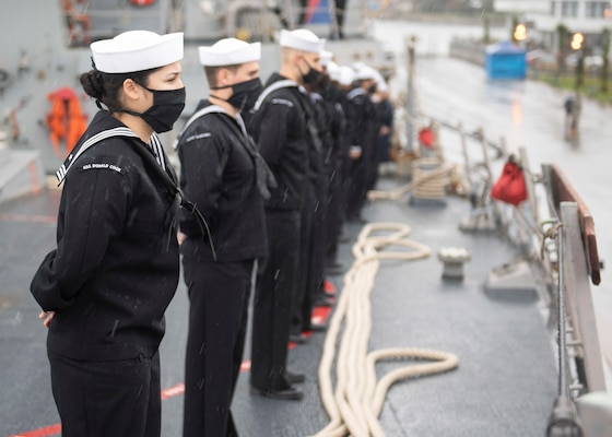 Sailors aboard the Arleigh Burke-class guided-missile destroyer USS Donald Cook (DDG 75) man the rails as the ship arrives in Batumi, Georgia, Feb. 5, 2021.