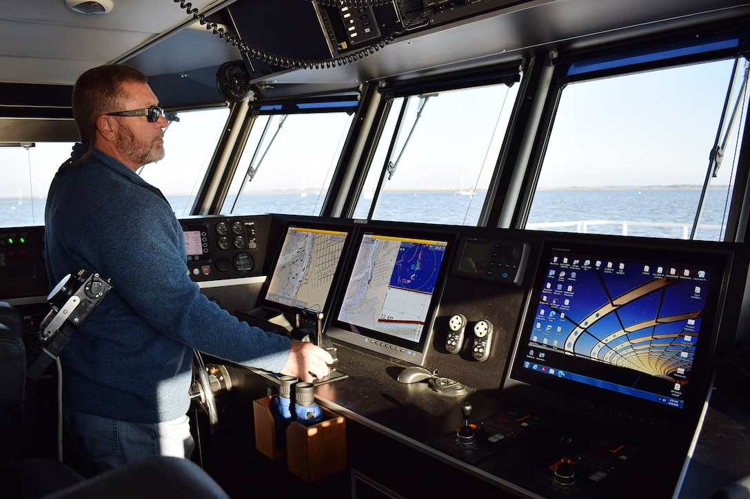 Tim Gregory, a captain onboard the U.S. Army Corps of Engineers, Jacksonville District Survey Vessel Florida II, plots coarse across the seas during a routine hydrographic survey