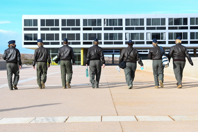 The aircrew from the first all-female flight of the KC-46 Pegasus walk the grounds of the United States Air Force Academy Jan. 22, 2021, in Colorado Springs, Colorado. The team sought to break down cultural and personal barriers female cadets face when competing for pilot training slots. (United States Air Force photo by Senior Airman Nilsa Garcia)