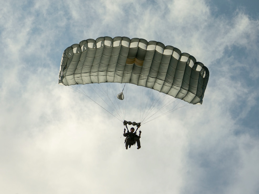 A U.S. Marine parachutes over Ie Shima, Okinawa, Japan, Jan. 26.