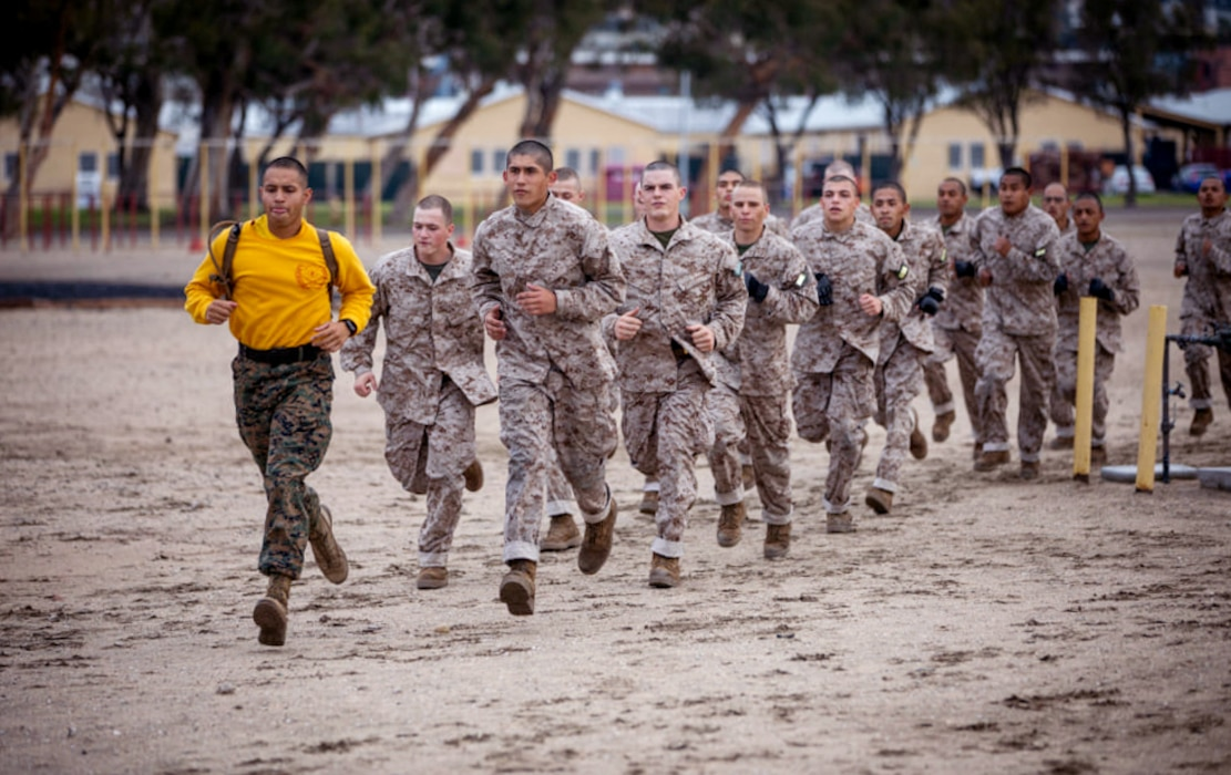 Recruits with Golf Company, 2nd Recruit Training Battalion, participate in the Confidence Course at Marine Corps Recruit Depot, San Diego, Feb. 1, 2021.