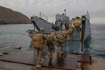 U.S. Marines and Sailors with 1st Battalion, 5th Marines, 1st Marine Division, board a landing craft, utility (LCU) during exercise Steel Knight/Dawn Blitz (SK/DB) 21 on San Clemente Island Dec. 8, 2020. DB/SK21 ensures the 1st Marine Division/ESG-3 team is optimized for naval expeditionary warfare in contested spaces and is purpose-built to facilitate sea denial and assured access in support of the naval fleet. (U.S. Marine Corps photo by Lance Cpl. Cameron Rowe)