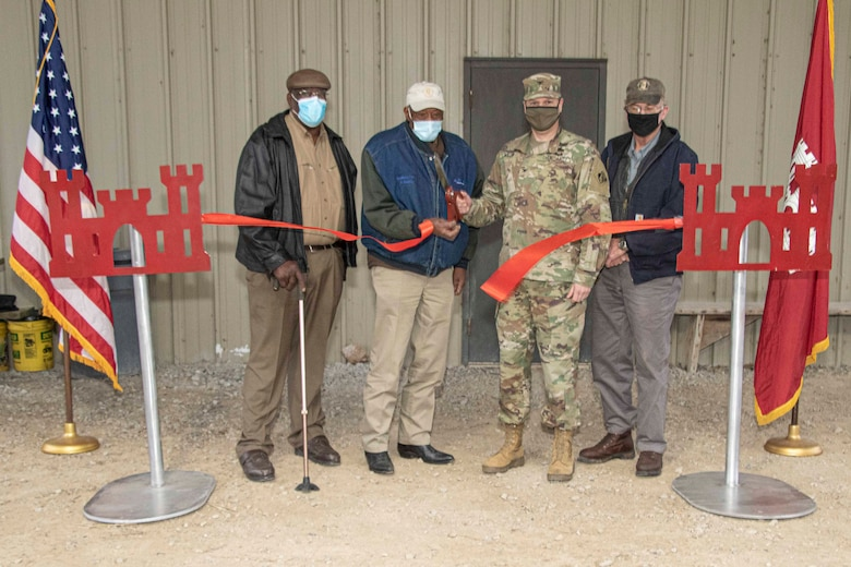IN THE PHOTO, Memphis District Commander Col. Zachary Miller, the district partner, and other district team members are briefed on the details of the project. Afterward, the group held a ribbon-cutting ceremony, symbolizing the victory and celebration of completing yet another significant project. (USACE photos by Vance Harris)