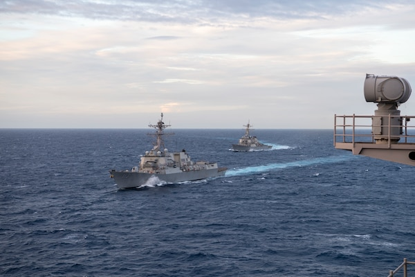 The Theodore Roosevelt  and Nimitz Carrier Strike Groups transit the South China Sea.