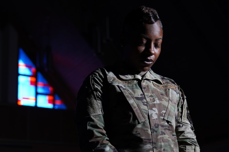 U.S. Air Force Senior Master Sgt. Jessica Player, Mathies NCO Academy director of education, takes time to give thanks inside the Larcher Chapel at Keesler Air Force Base Dec. 10, 2020. As a practicing Muslim, Player follows her faith to help strengthen her purpose. (U.S. Air Force photo by Airman 1st Class Seth Haddix)