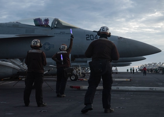 USS Theodore Roosevelt (CVN 71) and USS Nimitz (CVN 68) conduct dual-carrier operations in the South China Sea.