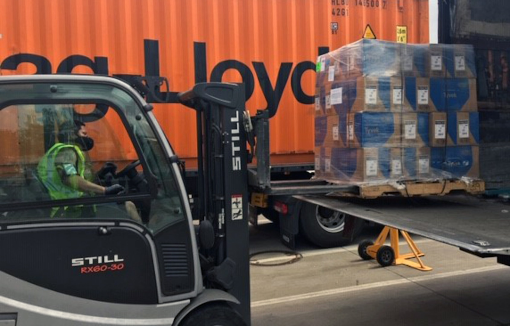 forklift operator moving a pallet of equipment