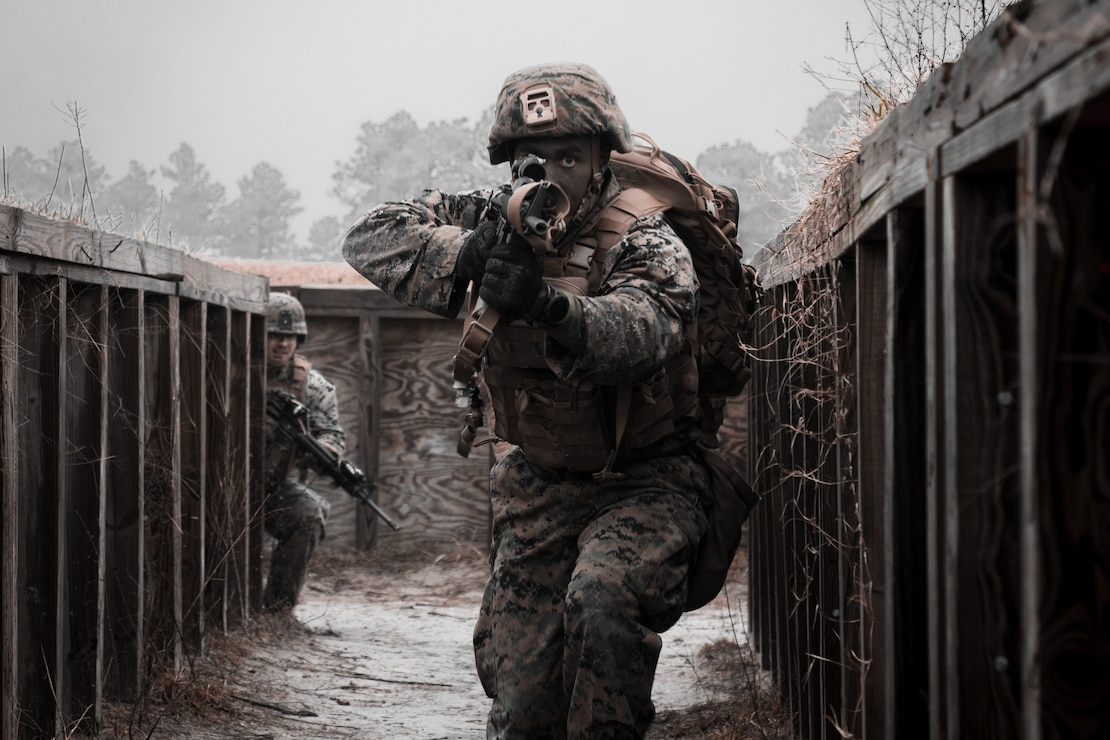 A U.S. Marine clears a simulated enemy cache site during a simulated live fire event on Camp Lejeune, N.C., Feb. 2.