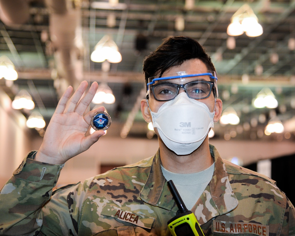 An image of a New Jersey Air National Guard member serving at the Atlantic City Convention Center, Atlantic City, N.J., to help the residents of New Jersey receive the COVID-19 vaccination at the Atlantic County Point Of Distribution mega-site.