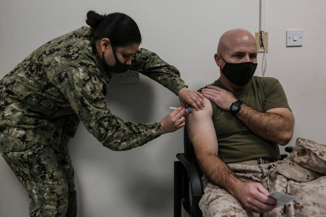 BGen Farrell J. Sullivan receives the first dose of the Moderna COVID-19 Vaccine aboard Naval Support Activity Bahrain Jan. 21, 2021.