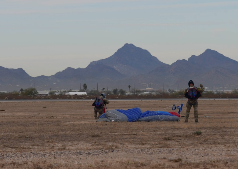 U.S. Air Force pararescuemen packing their parachutes