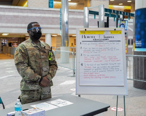 An image of a N.J. Air National Guard member serving at the Atlantic City Convention Center, Atlantic City, N.J., Jan. 27, 2021, which was set up as a COVID-19 vaccination Point of Distribution Center.