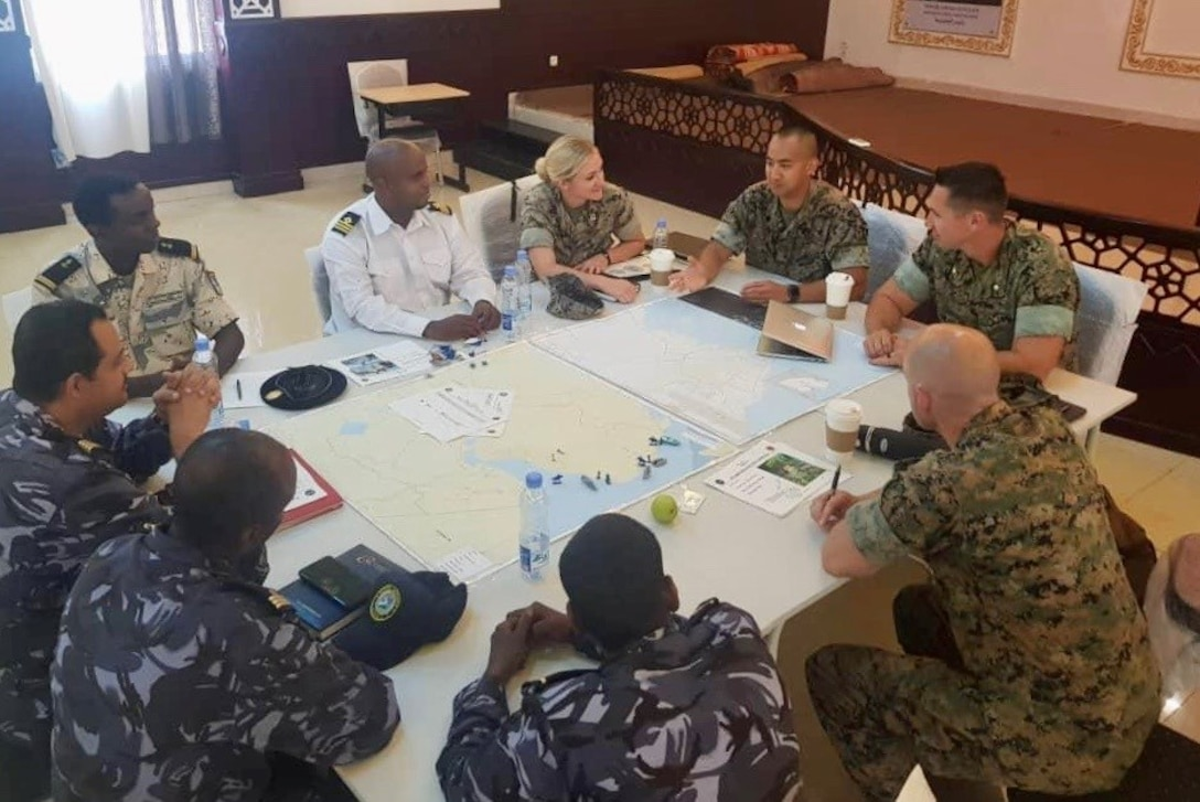 MARFOREUR/AF, Capt Burgett (Regional Planner and Africa Regional Affairs Officer), Capt Halverson (Africa Foreign Area Officer In-Training) with MCSCG, Maj Osborne (Africa Section Deputy) and SSgt Wee (Africa Foreign Area SNCO), conducted a Maritime Operations Center Ground Force Integration (MOC-GFI) table top exercise with the Djiboutian Military from. This exercise is in conjunction with CUTLASS EXPRESS 19.2.