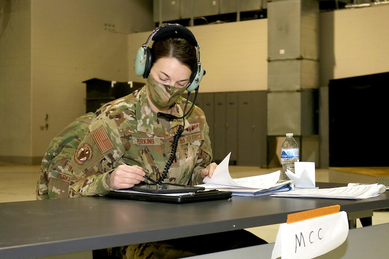 Capt. Emily Perkins, a flight nurse with the 445th Aeromedical Evacuation Squadron, checks information on her tablet during a mission brief Jan. 9, 2021.