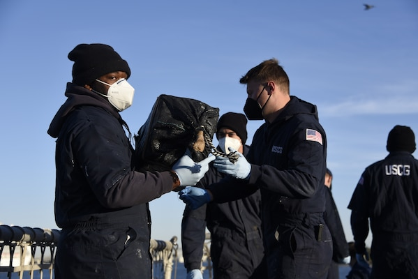 The Coast Guard Cutter Campbell (WMEC 909) crew offloads approximately 7,250 pounds of cocaine at Port Everglades, Florida, Feb. 4, 2021.