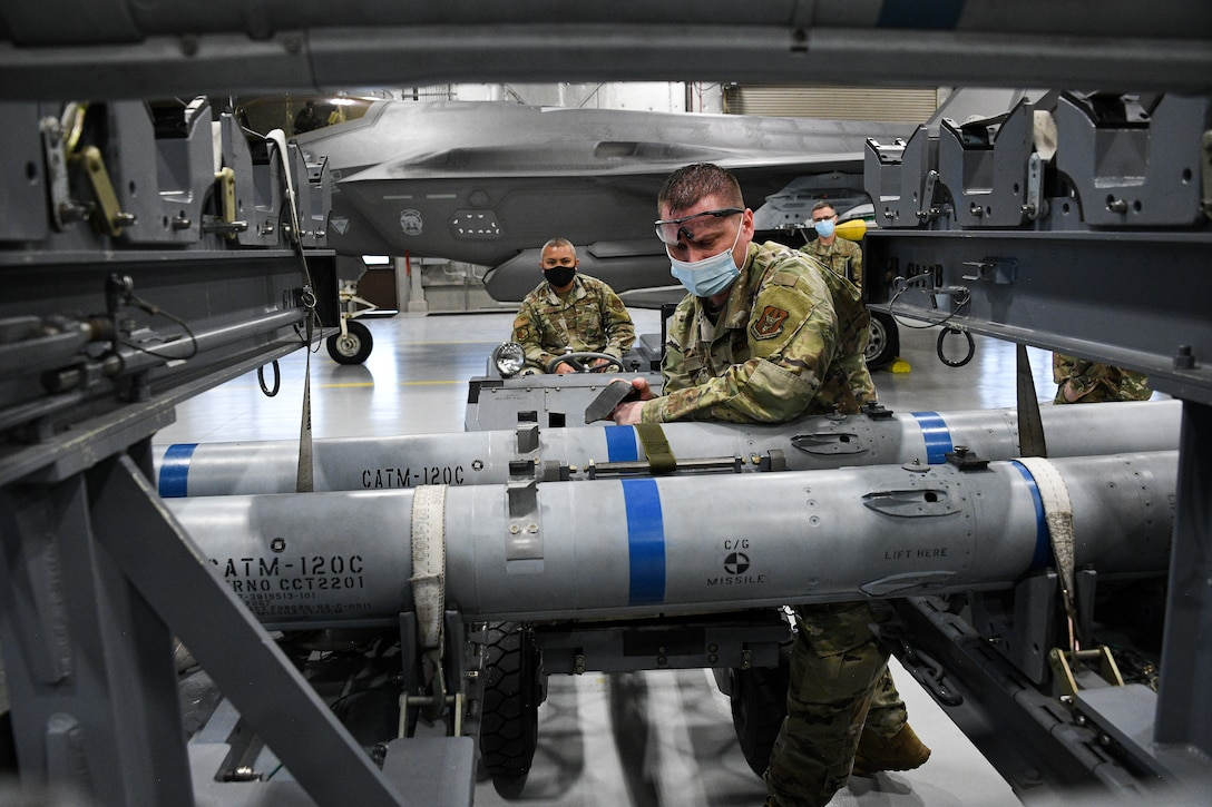 A photo of F-35 maintainers loading weapons
