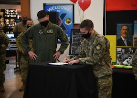 Minot Air Force Base leadership signs a Black History Month proclamation.