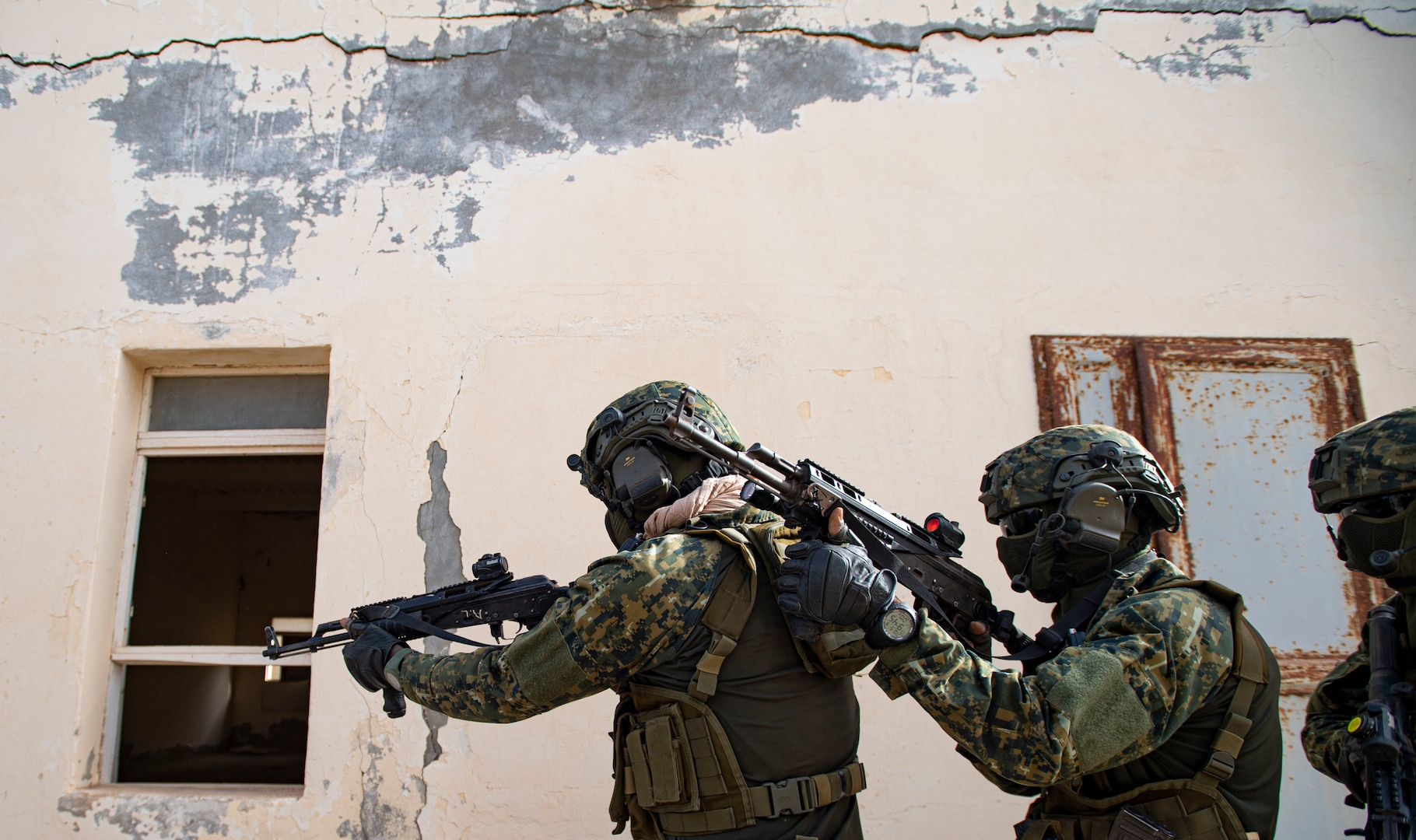 Guinean special forces soldiers conduct close quarters battle training in abandoned hotel