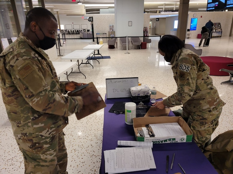 New York National Guard Soldiers and Airmen are collecting health information forms from travelers arriving in New York from out-of-state and international destinations at 12 airports around the state.