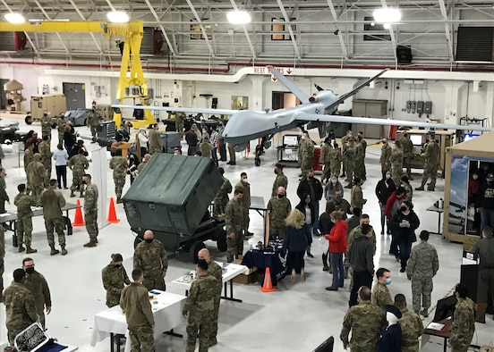 Members of the 174th Attack Wing speak with potential recruits during a career fair Feb. 6, 2021
