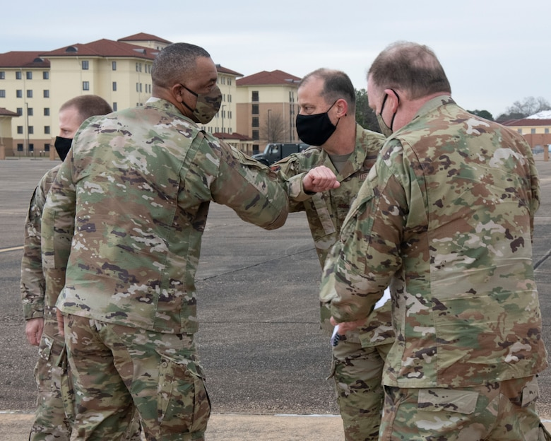 Chief Master Sgt. Timothy White (left), Air Force Reserve Command command chief, is greeted by Col. Craig Drescher (center), 908th Airlift Wing commander, with Lt. Gen. Richard Scobee (right)