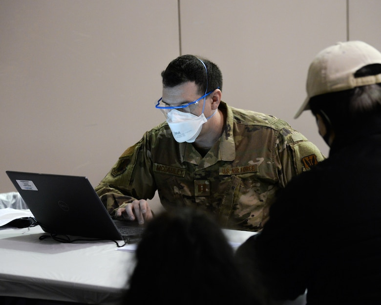 An image of Nj Air National Guard members serving at the Atlantic City Convention Center, Atlantic City, N.J. to help the residents of New Jersey to receive the COVID-19 vaccination at the Atlantic County Point Of Distribution mega-site.