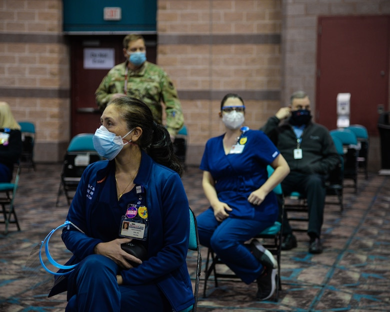 An image of NJ Air National Guard and AtlantiCare Regional Health Services members serving at the Atlantic City Convention Center, Atlantic City, N.J., to help the residents of New Jersey receive the COVID-19 vaccination at the Atlantic County Point Of Distribution mega-site.