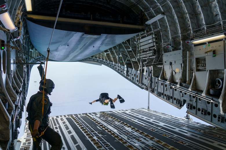 Maj. Brock Roden, a combat rescue officer with 212th Rescue Squadron, Alaska Air National Guard, conducts a freefall-parachute jump into the Pacific Ocean from a C-17 Globemaster III aircraft near Kapolei, Hawaii, Jan. 26, 2021, during Exercise H20. Alaska Air National Guardsmen were in Hawaii training during Exercise H20 in January and February, honing their long-range search and rescue capability in support of the NASA human spaceflight program .
