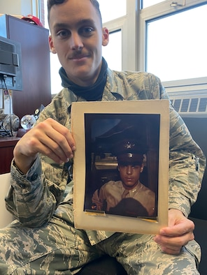 Airman 1st Class Stephen D. Gallwey, 270th Engineering Installation Squadron cable antenna technician, with a photo of his grandfather, 1st Lt. James H. Gallwey, an original Tuskegee Airmen pilot, Dec. 6, 2020, in Horsham, Pennsylvania. His grandfather's legacy motivated his decision to join the Air National Guard.