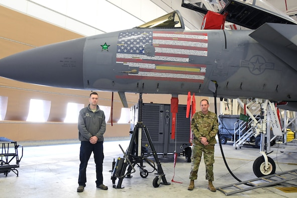 U.S. Air Force 104th Fighter Wing's flagship F-15C Eagle sits in the base's Main Hangar January 22, 2021, at Barnes Air National Guard Base, Mass. The F-15 received new decals that represent the American flag and every member in the wing. (U.S. Air National Guard photo by Staff Sgt. Hanna Smith)