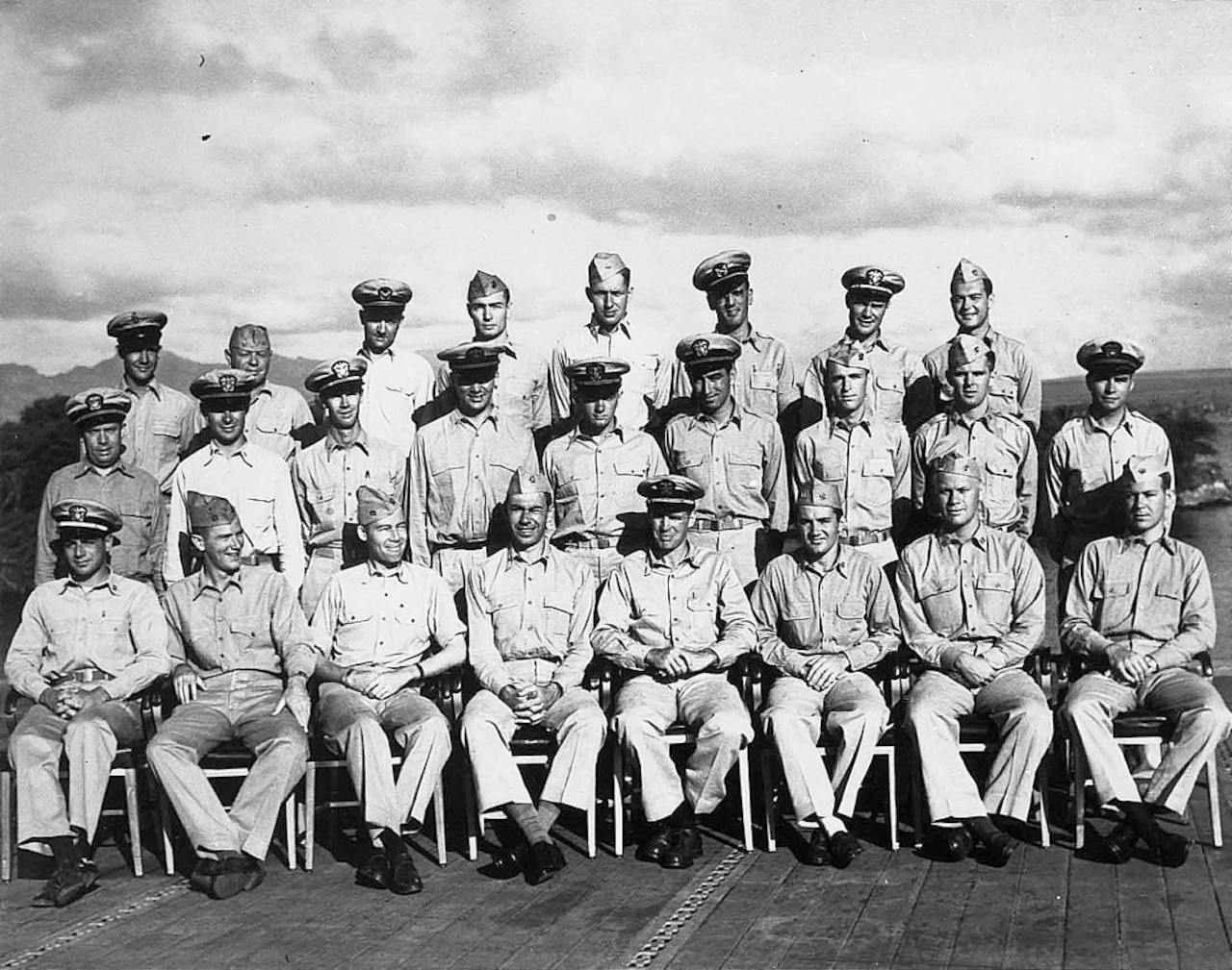 Navy officers pose for a group photo.