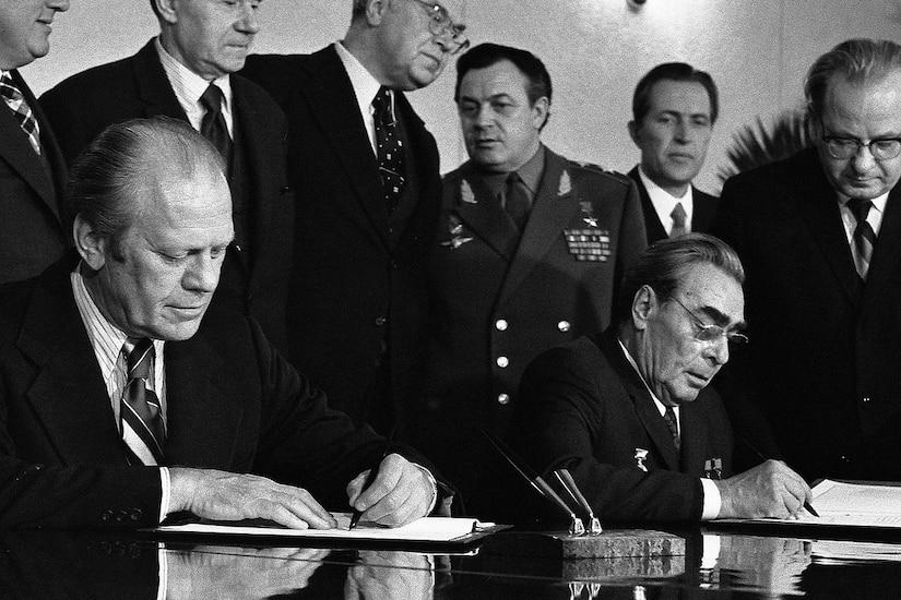 Men sign a treaty.