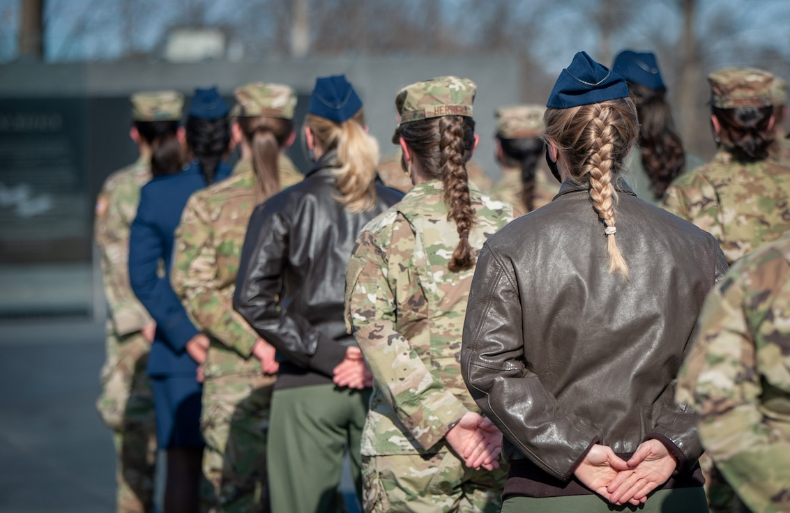 As an outcome of the 101st Air Force uniform board, Air Force women will be able to wear their hair in up to two braids or a single ponytail with bulk not exceeding the width of the head and length not extending below a horizontal line running between the top of each sleeve inseam at the under arm through the shoulder blades. In addition, women's bangs may now touch their eyebrows, but not cover their eyes. These new changes will be effective upon publication of the new standards in Air Force Instruction 36-2903 Feb. 10. (U.S. Air Force photo by Chief Master Sgt. Jaimee Freeman)