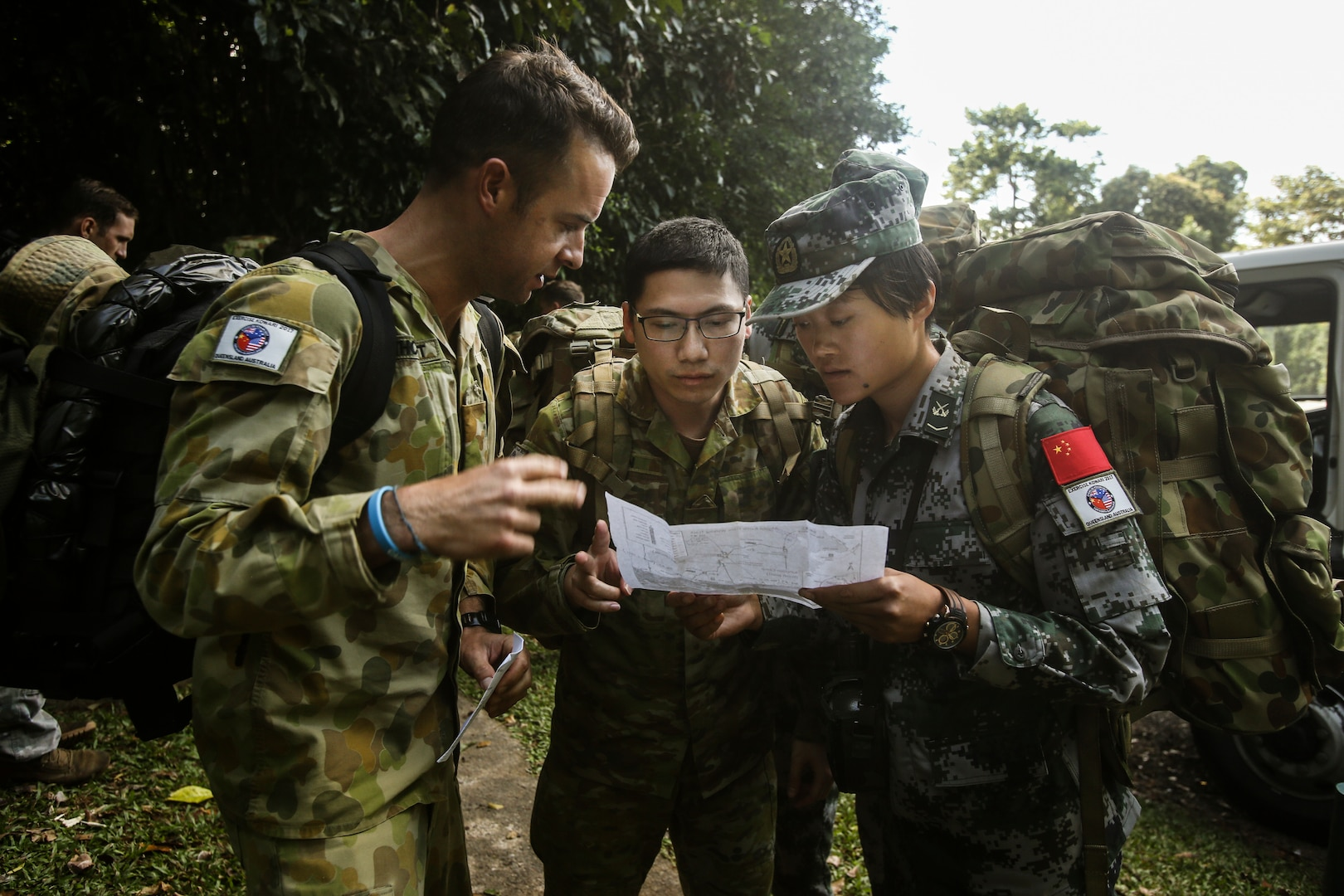 Chinese People's Liberation Army receives route map with instructions before leading her team of fellow Chinese soldiers, U.S. Marines, and Australian soldiers to summit of Queensland's highest peak during Exercise Kowari 2017