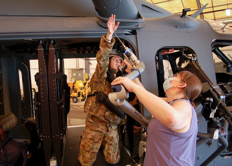 U.S. Air Force Capt. Megan E. Burk, of the 413th Test Squadron, performs tasks during an anthropometric accommodation evaluation on the MH-139A Grey Wolf at Eglin Air Force Base, Florida, in August 2020. This study is part of a multi-agency effort to create the first anthropometric entry standards for U.S. Air Force career enlisted aviators. (Courtesy Photo)