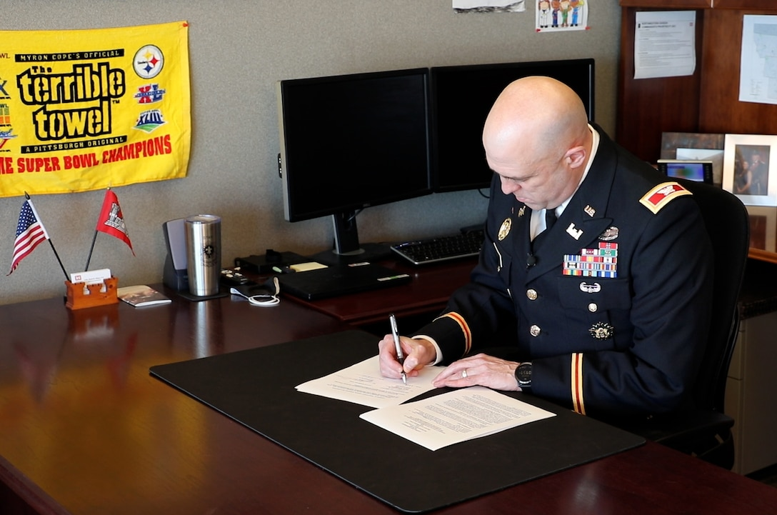 U.S. Army Corps of Engineers, Omaha District Commander Col. Mark Himes signs a Section 1176 project agreement Tuesday that will allow the District to raise the Hamburg Ditch 6 levee eight feet, significantly increasing the flood risk management benefits the levee provides to the city.