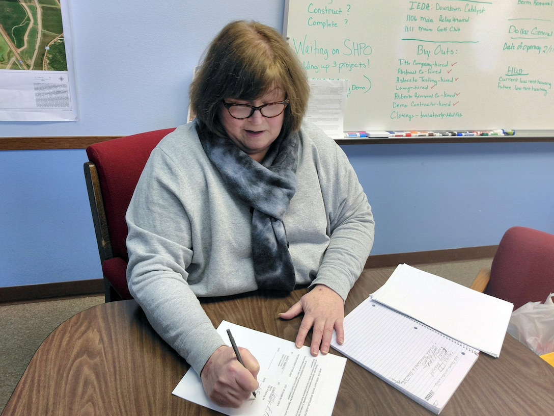 Hamburg Mayor Cathy Crain signs a Section 1176 project agreement Monday that will allow the U.S. Army Corps of Engineers to raise the Hamburg Ditch 6 levee eight feet, significantly increasing the flood risk management benefits the levee provides to the city.
