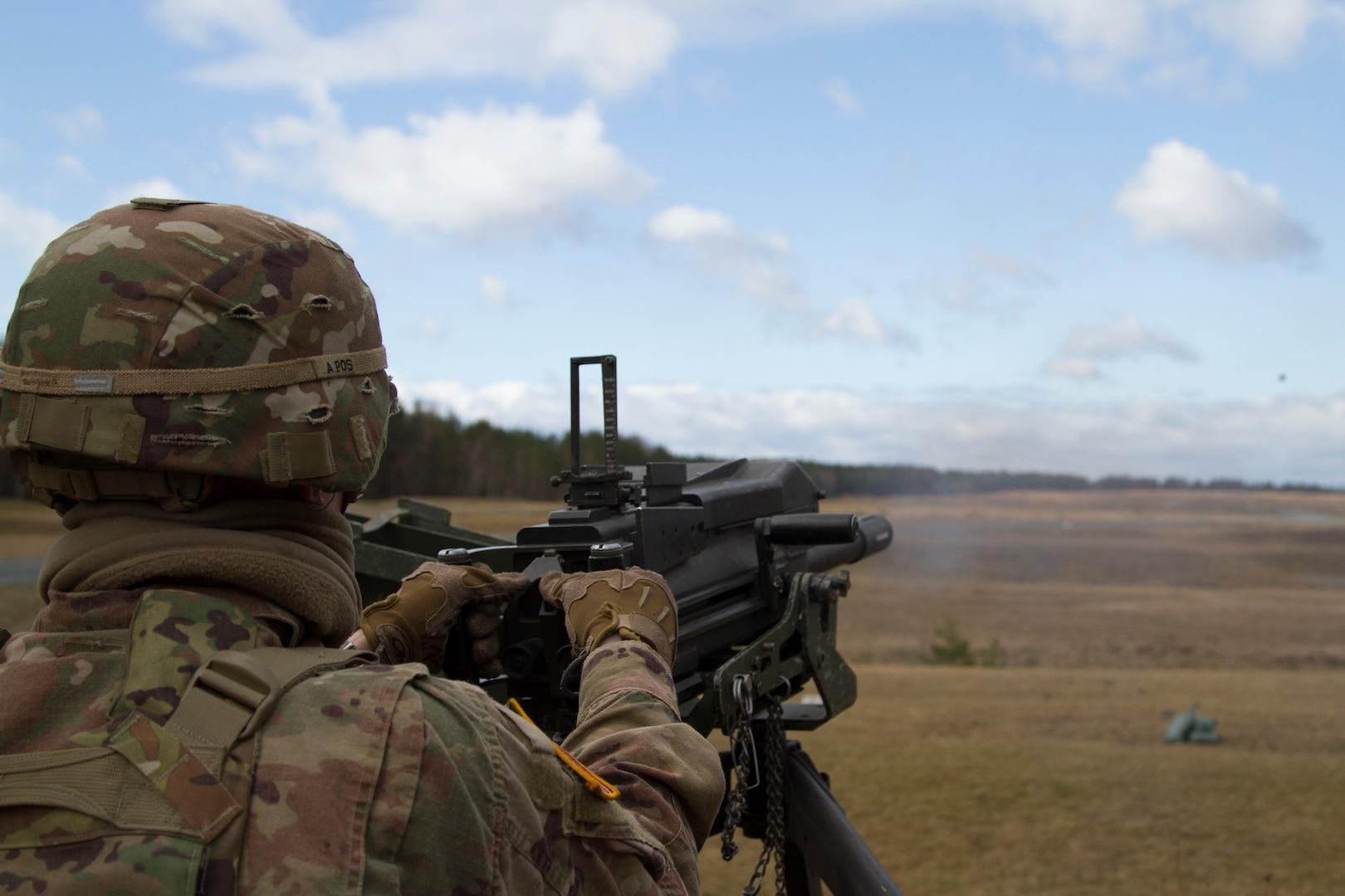 Soldier launches grenade down range with MK-19mm grenade machine gun