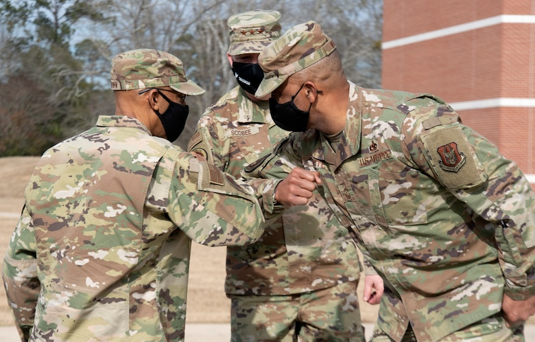Air Force Chief of Staff, Gen. Charles Q. Brown Jr. (L), greets Air Force Reserve Command senior leaders Lt. Gen. Richard W. Scobee and Chief Master Sergeant Timothy C. White, upon his arrival to Air Force Reserve Command headquarters on Robins Air Force Base in Georgia on Feb. 8, 2021. While at the headquarters, Brown discussed COVID-19 response efforts, diversity and inclusion issues, readiness, and the role of the Air Force Reserve in the future fight. (U.S. Air Force photo by Master Sgt. Stephen D. Schester)