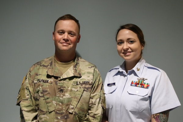U.S. Army Staff Sgt. Nicholas Parker and his wife, U.S. Coast Guard Petty Officer Second Class Andrea Parker smile for a photo on February 4, 2019, at Andersen Air Force Base, Guam