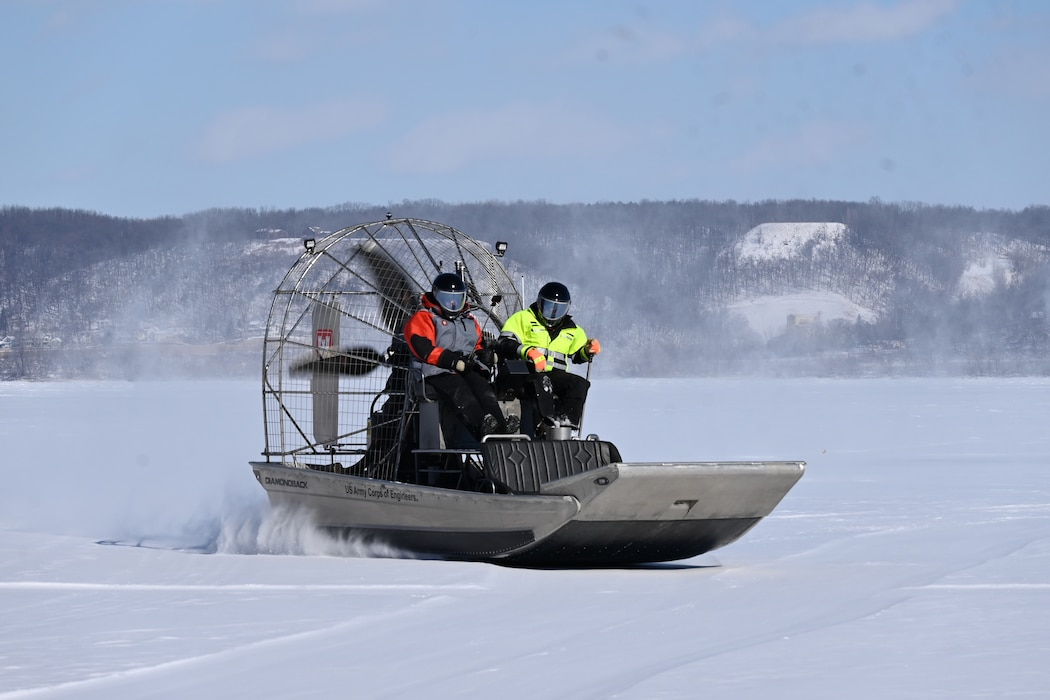 Crew use airboat to conduct ice surveys