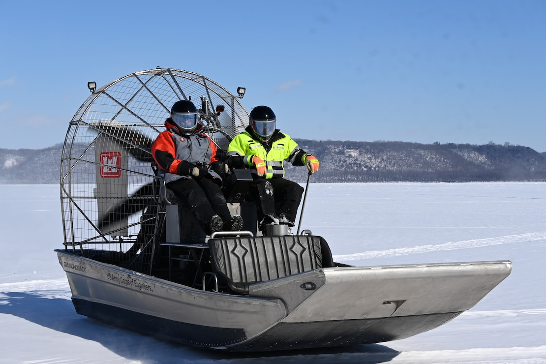 Crew ride airboat to conduct ice surveys