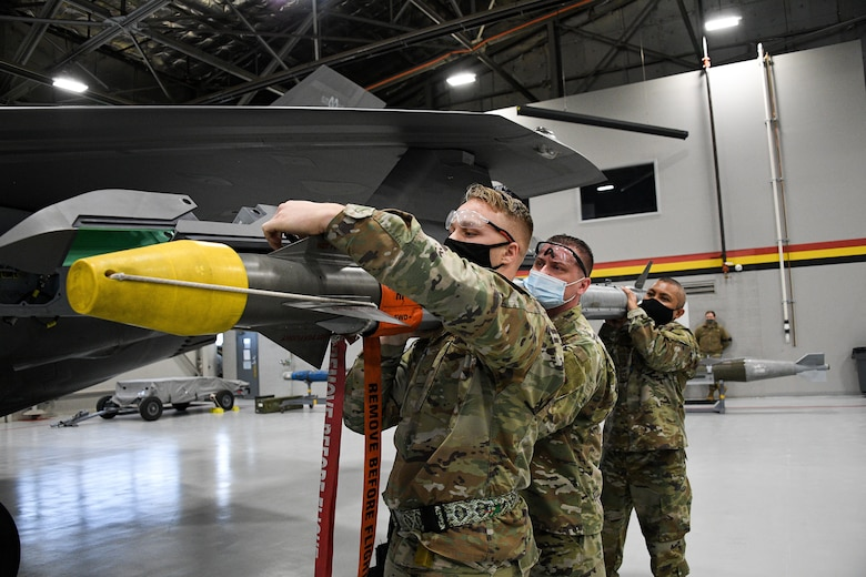 Air Force Reserve maintainers from the 466th Aircraft Maintenance Unit participate in an annual F-35 weapons load competition