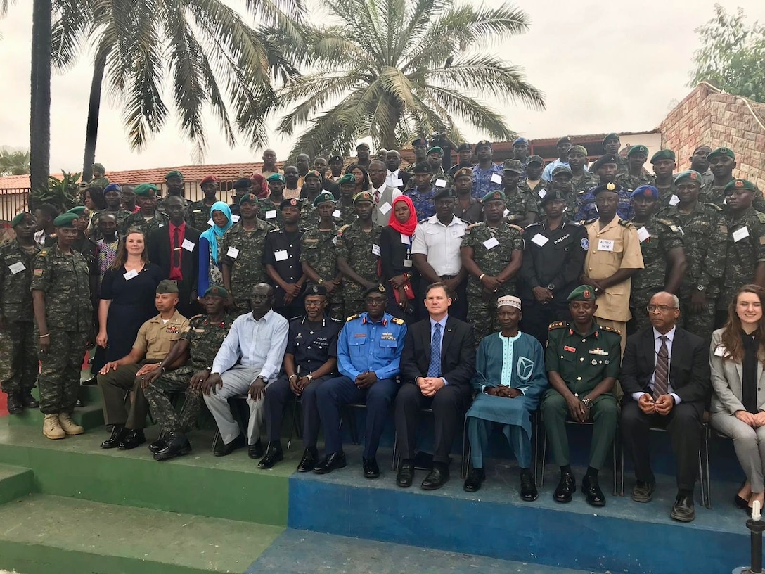 Capt Defay provided support to the Naval Postgraduate School's Institute for Security Governance in The Gambia. The event involved strengthening the bond between civilian leaders, the media, and the Gambian Armed Forces to promote democracy. Centered is U.S. Ambassador to The Gambia, Ambassador Richard Paschall and to his right was Chief of the Naval Staff, Commodore Senghor.