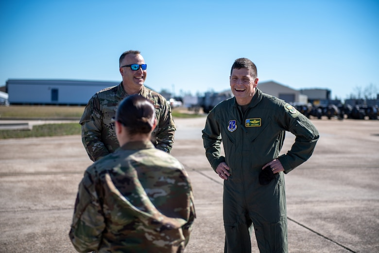 Brig. Gen. Henry Harder, assistant adjutant general - air, Vermont National Guard, and Col. Adam Rice, vice wing commander, 158th Fighter Wing, enjoy conversation with MSgt Victoria Cadieux.