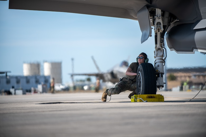 Senior Airman Isabel Murphy, a crew chief assigned to the 158th Maintenance Group, Vermont Air National Guard, prepares to launch an F-35A Lightning II during a training exercise.
