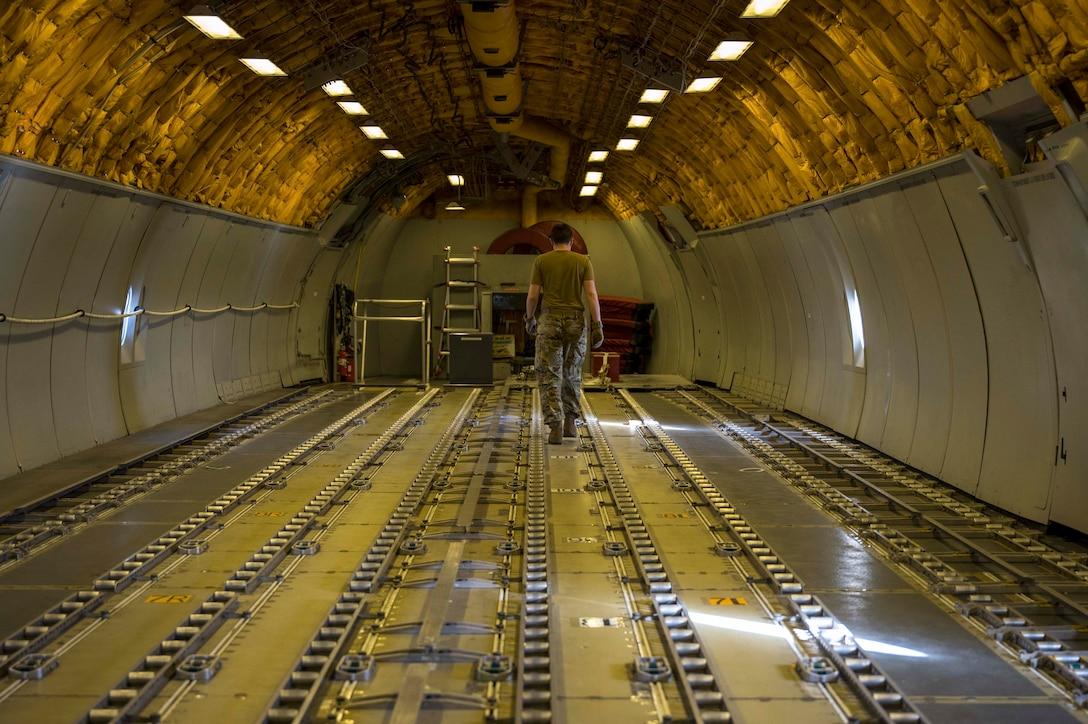 An airman walks in an aircraft.